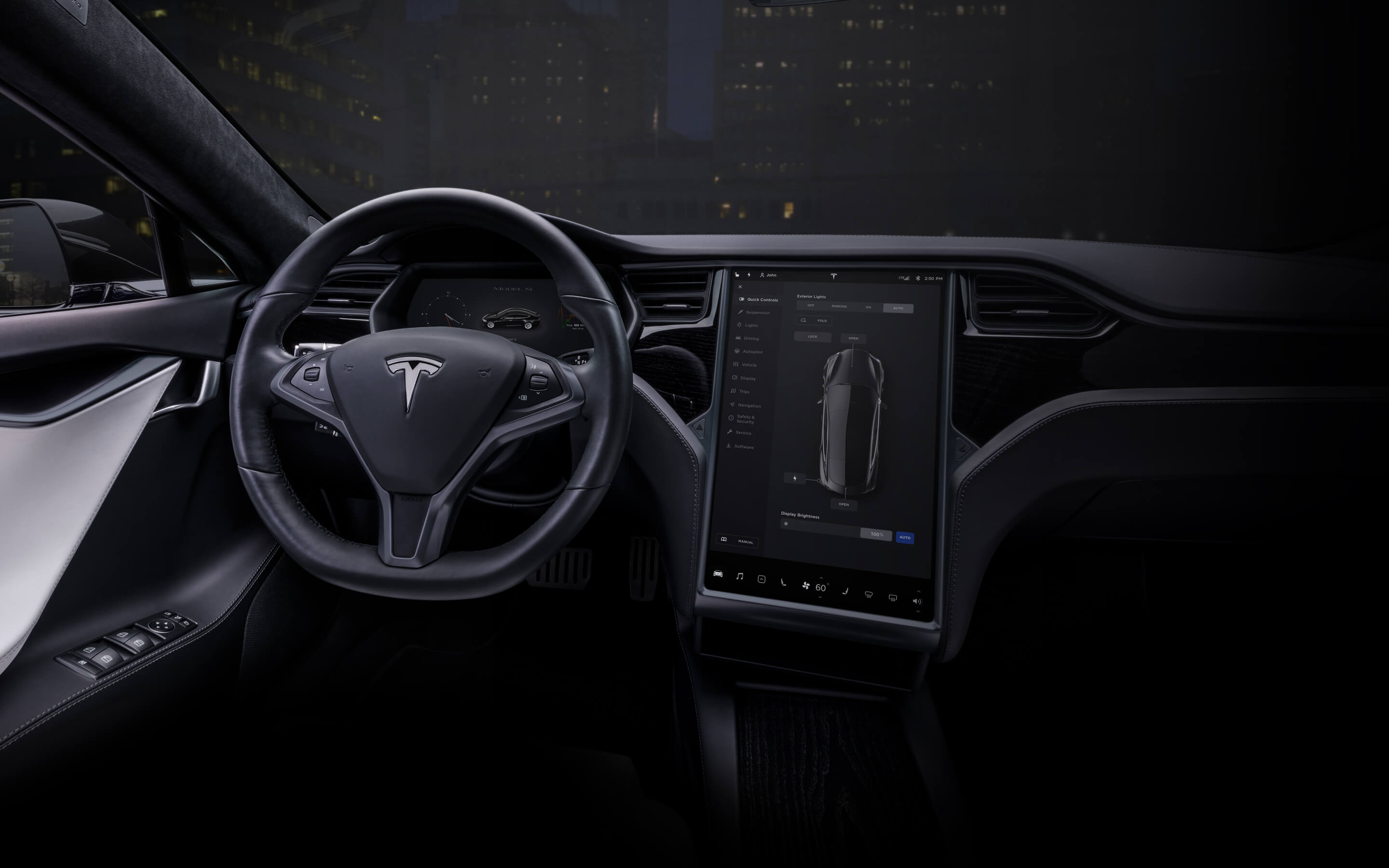 """Black Model S interior with 17"""" touchscreen and steering wheel"""