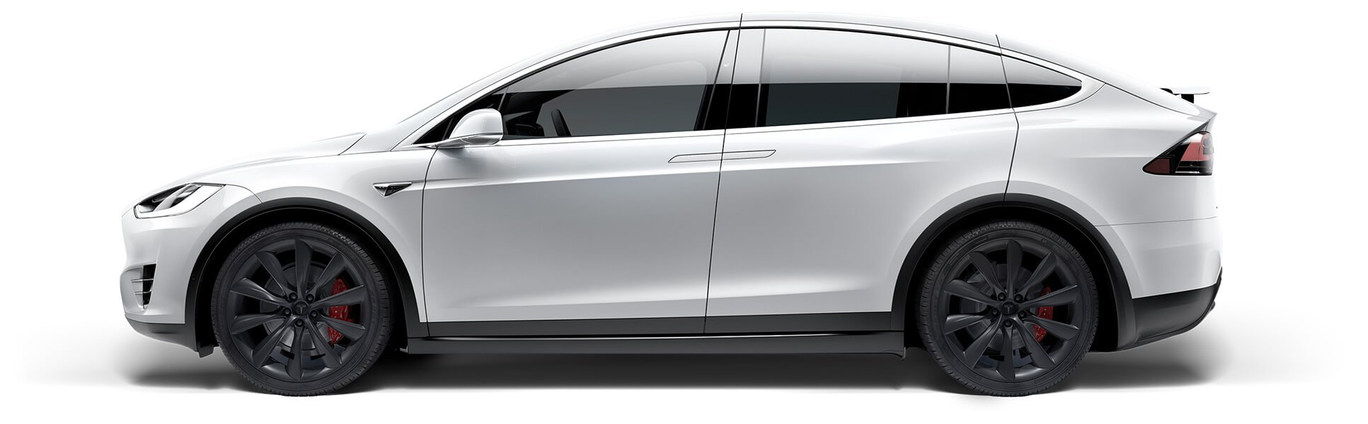 Side view of pearl white Model X